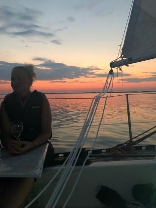 Riina, mainsail and sunset.